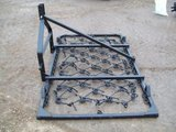 Mounted folding chain harrow