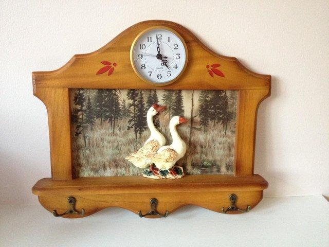 Unusual goose clock with hanging hooks for keys brand Unusual clocks for sale