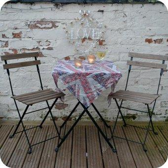 garden table with a scarf as a table cloth