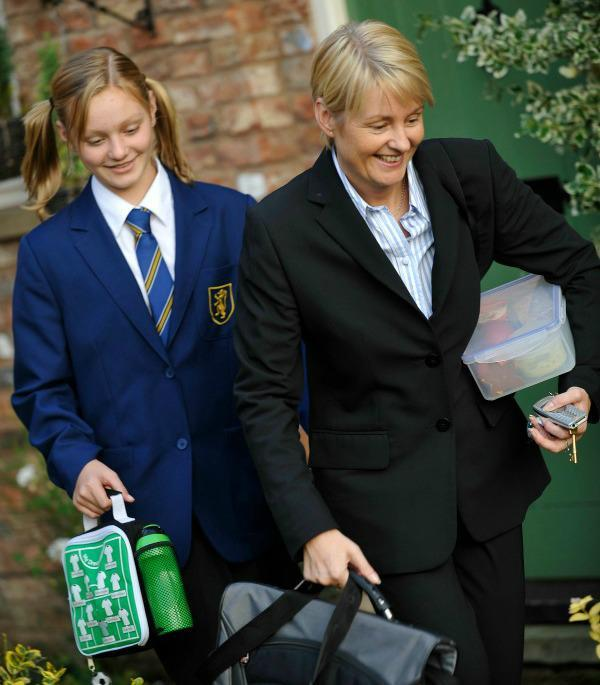 mother and daughter going to work and school with lunch boxes