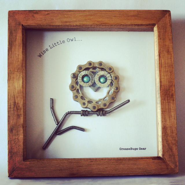 owl made of bike chains in a frame