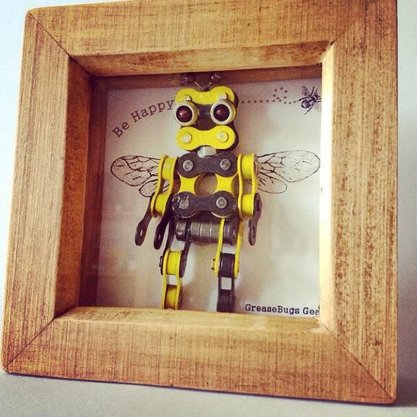 bumblebee in a picture frame made out of bike chains