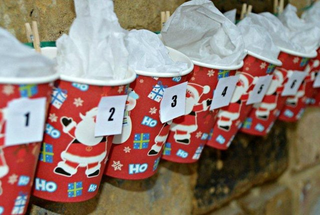 christmas paper cups pegged onto string