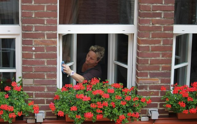 lady cleaning a window