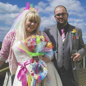 cariad and her husband on their wedding day