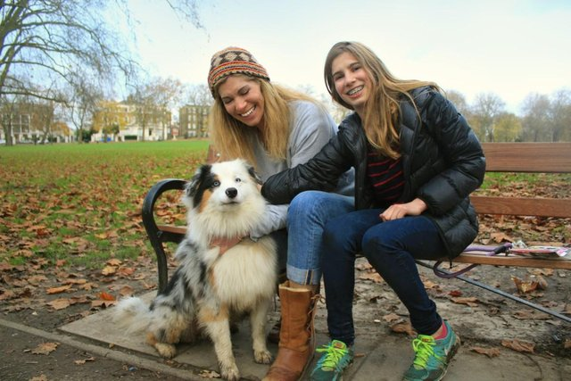 two women and dog