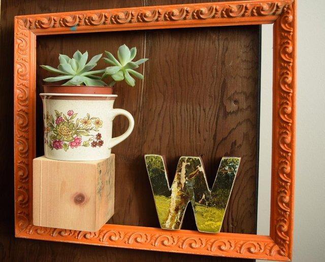 Frame with plants and letters