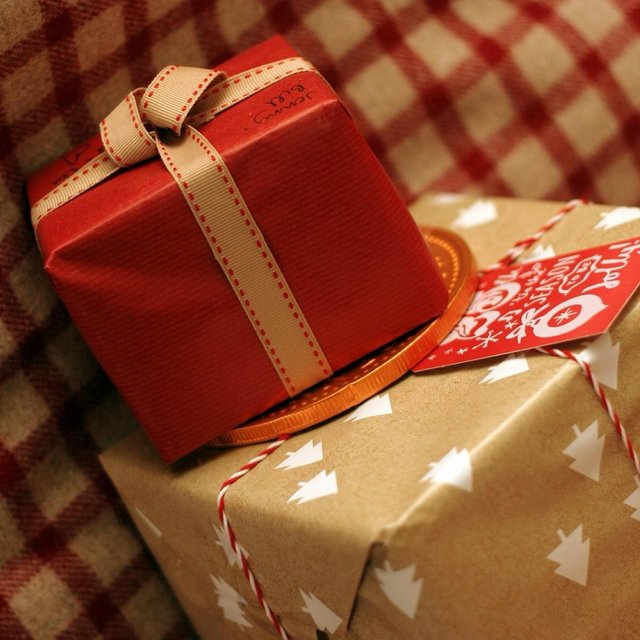 red present and brown wrapping paper