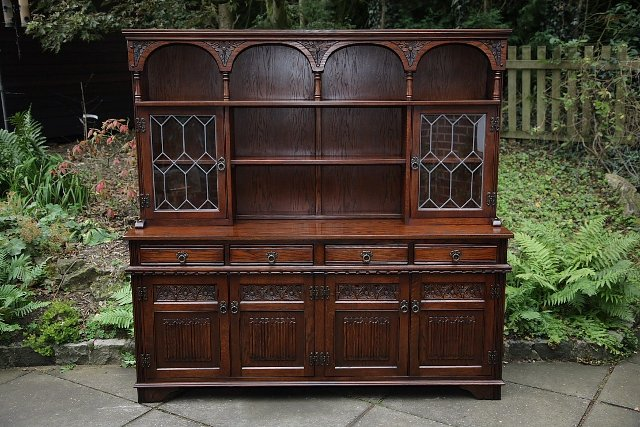 Preview of the first image of OLD CHARM TUDOR BROWN DRESSER BASE SIDEBOARD DISPLAY CABINET.