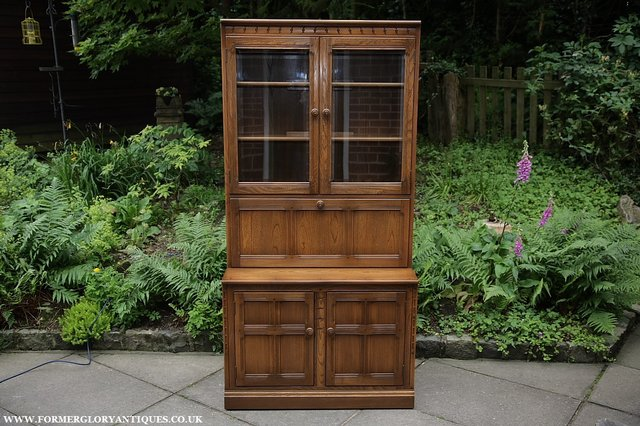 Preview of the first image of ERCOL GOLDEN DAWN DRINKS DISPLAY CABINET BOOKCASE CUPBOARD..