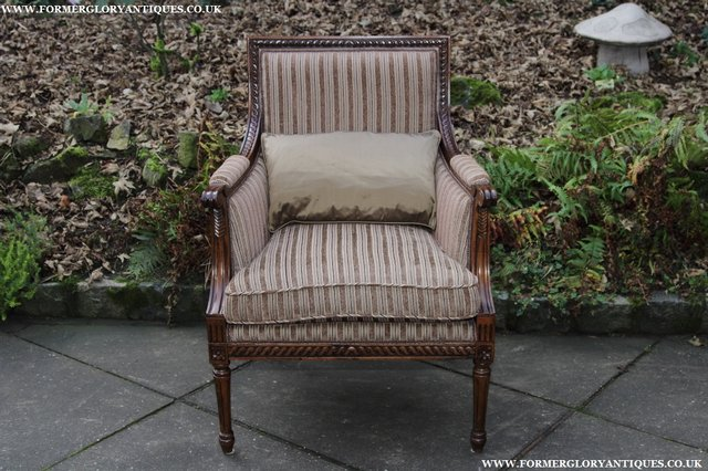 Image 2 of A FRENCH LOUIS MAHOGANY STYLE UPHOLSERED READING ARMCHAIR.