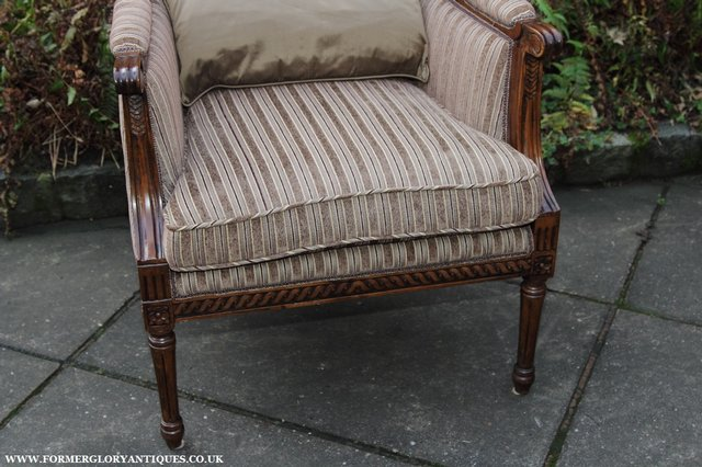 Image 3 of A FRENCH LOUIS MAHOGANY STYLE UPHOLSERED READING ARMCHAIR.