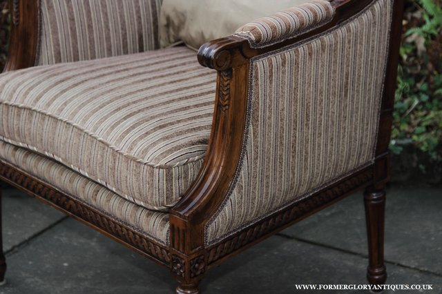 Image 4 of A FRENCH LOUIS MAHOGANY STYLE UPHOLSERED READING ARMCHAIR.