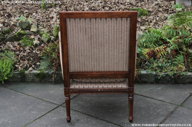 Image 6 of A FRENCH LOUIS MAHOGANY STYLE UPHOLSERED READING ARMCHAIR.