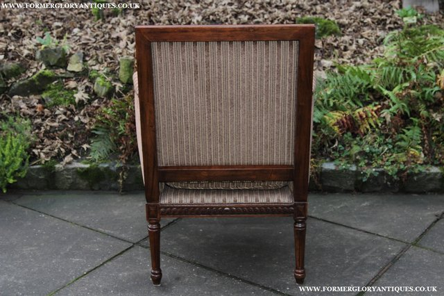 Image 9 of A FRENCH LOUIS MAHOGANY STYLE UPHOLSERED READING ARMCHAIR.