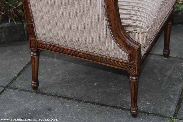 Image 12 of A FRENCH LOUIS MAHOGANY STYLE UPHOLSERED READING ARMCHAIR.