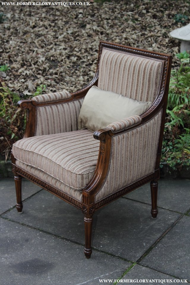 Image 16 of A FRENCH LOUIS MAHOGANY STYLE UPHOLSERED READING ARMCHAIR.