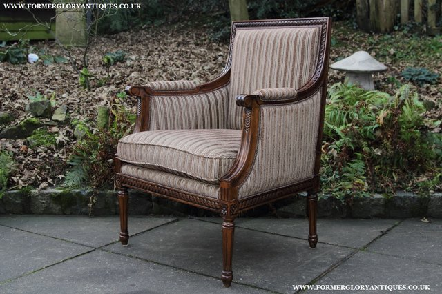 Image 25 of A FRENCH LOUIS MAHOGANY STYLE UPHOLSERED READING ARMCHAIR.