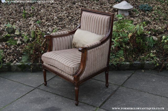 Image 28 of A FRENCH LOUIS MAHOGANY STYLE UPHOLSERED READING ARMCHAIR.
