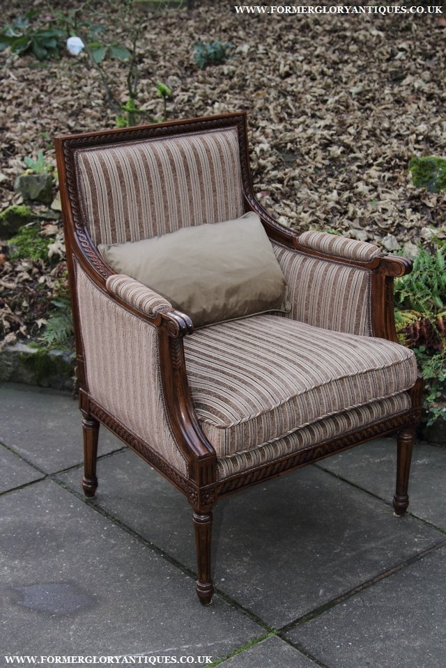 Image 30 of A FRENCH LOUIS MAHOGANY STYLE UPHOLSERED READING ARMCHAIR.