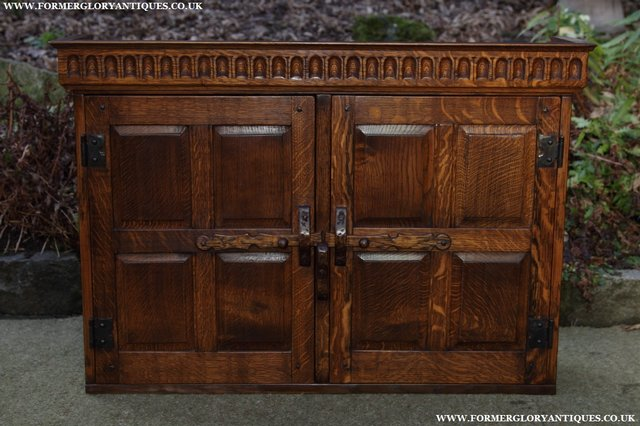 Preview of the first image of NIGEL GRIFFITHS OAK WALL HANGING CABINET CUPBOARD BOOKCASE.