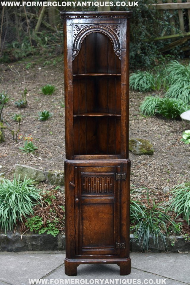Preview of the first image of TITCHMARSH GOODWIN OAK DISPLAY CORNER CABINET BOOKCASE.