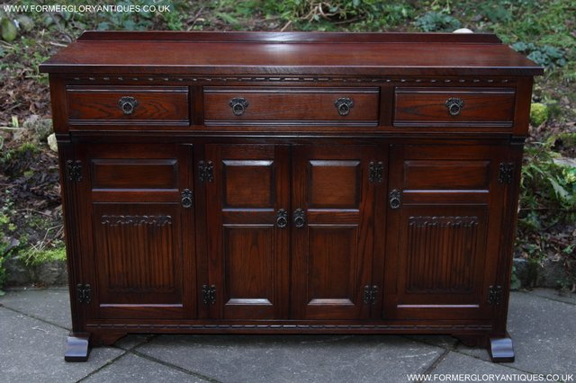 Preview of the first image of OLD CHARM TUDOR OAK SIDEBOARD DRESSER BASE CABINET TABLE.