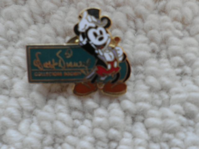 Preview of the first image of DISNEY MICKEY MOUSE BADGE.
