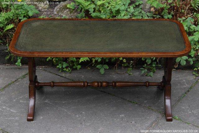 Preview of the first image of A BEVAN FUNNELL LEATHER OCCASIONAL COFFEE LAMP SOFA TABLE.