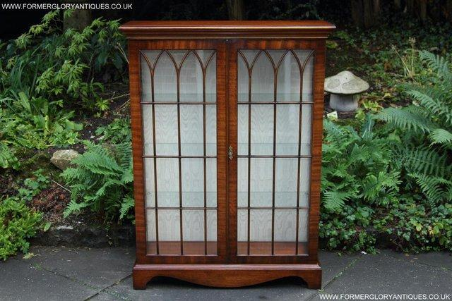 Preview of the first image of BEVAN FUNNELL MAHOGANY DISPLAY CHINA CABINET BOOKCASE.
