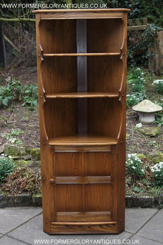 Preview of the first image of ERCOL GOLDEN DAWN CORNER CABINET CUPBOARD STAND TABLE SHELF.