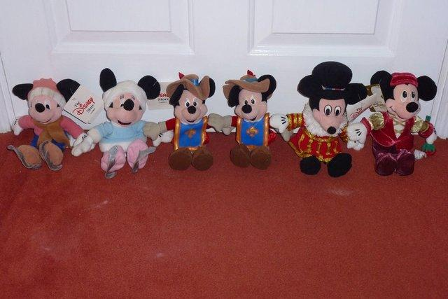 Preview of the first image of Various Beanie Babies including Mickey, Minnie and Pooh.