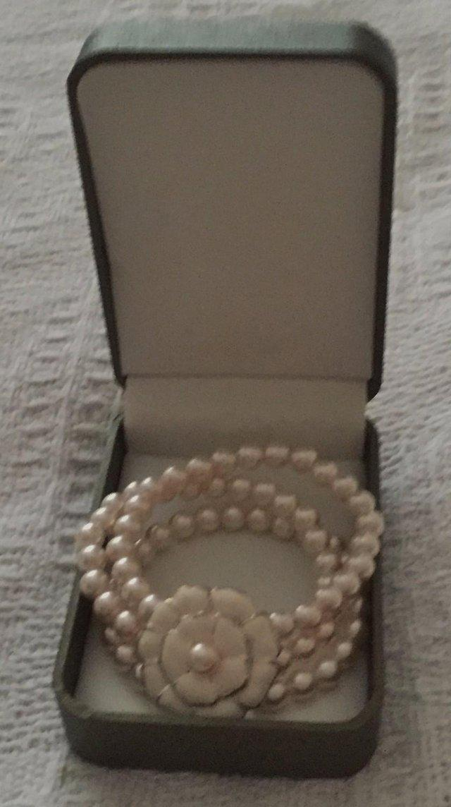 Preview of the first image of Beautiful Coleen Rooney's womens faux pearl bracelet.