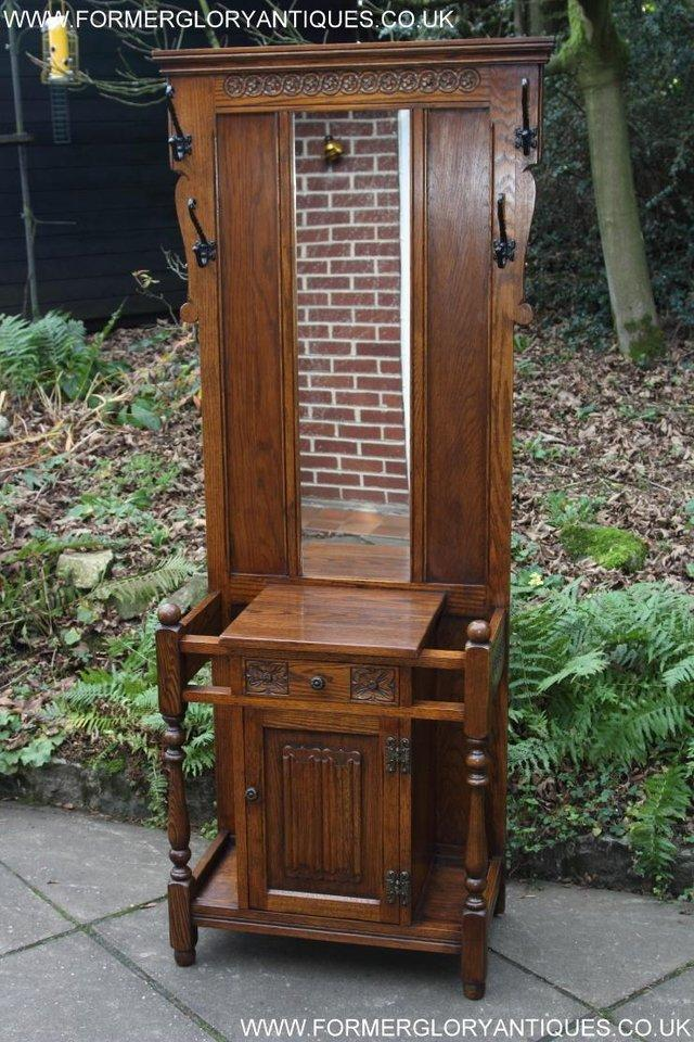 Preview of the first image of AN OLD CHARM JAYCEE LIGHT OAK HALL COAT STICK STAND CABINET.
