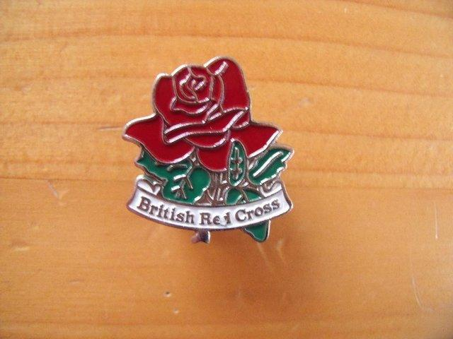 Preview of the first image of British Red Cross badge/pin + butterfly back..