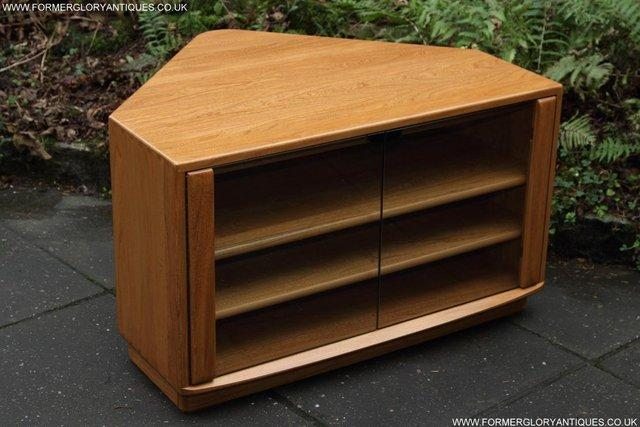 Preview of the first image of ERCOL WINDSOR LIGHT ELM CORNER TV CABINET STAND TABLE UNIT.