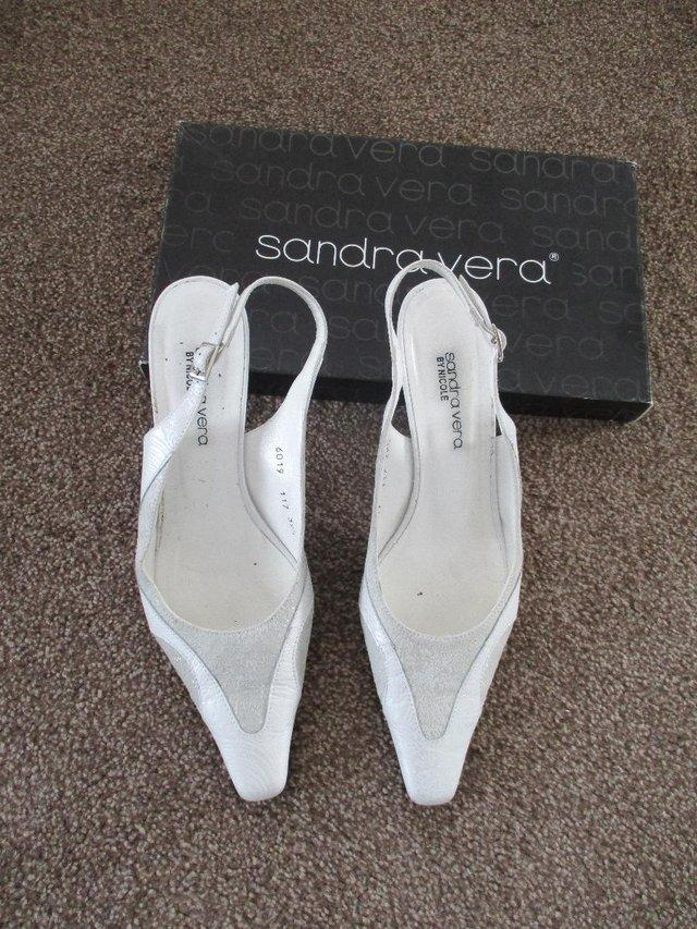 Preview of the first image of Sandra Vera shoes and matching clutch bag..