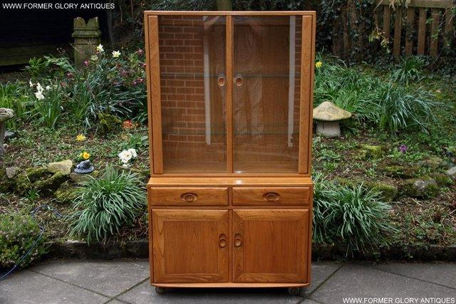 Preview of the first image of ERCOL LIGHT ELM DISPLAY CABINET CUPBOARD SIDEBOARD DRESSER.