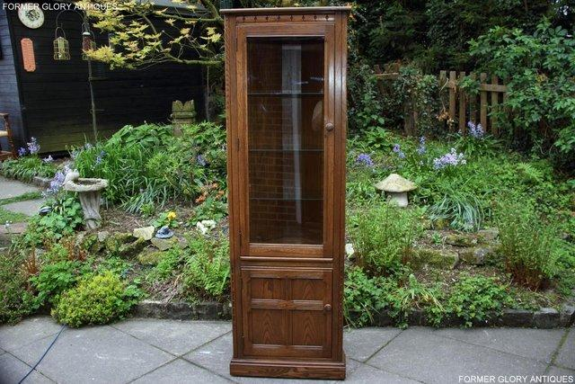 Preview of the first image of AN ERCOL GOLDEN DAWN CORNER DISPLAY CABINET CUPBOARD STAND.