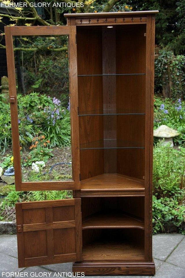 Image 38 of AN ERCOL GOLDEN DAWN CORNER DISPLAY CABINET CUPBOARD STAND