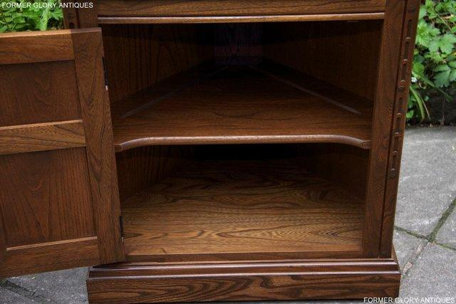 Image 49 of AN ERCOL GOLDEN DAWN CORNER DISPLAY CABINET CUPBOARD STAND