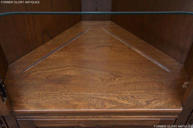 Image 57 of AN ERCOL GOLDEN DAWN CORNER DISPLAY CABINET CUPBOARD STAND