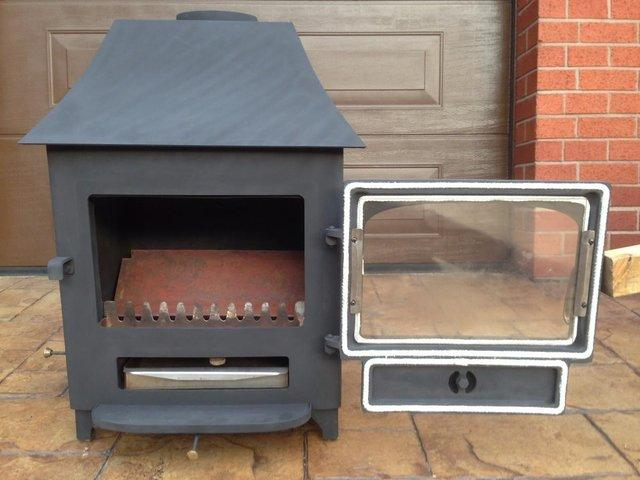 Preview of the first image of Clearview stove log burner multi fuel stove.
