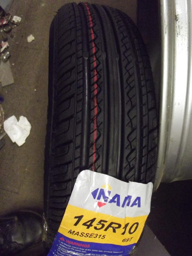 """Preview of the first image of CLASSIC MINI OR TRAILER 10"""" TYRES NEW 145 10."""