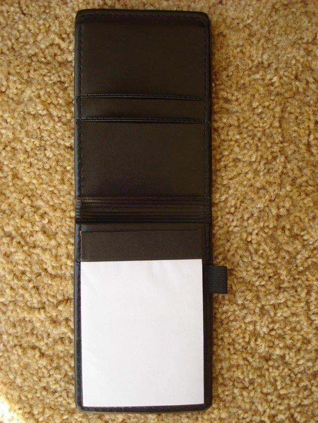 Preview of the first image of NEW  BLACK LEATHER LOOK NOTEPAD HOLDER WITH PEN HOLDER.