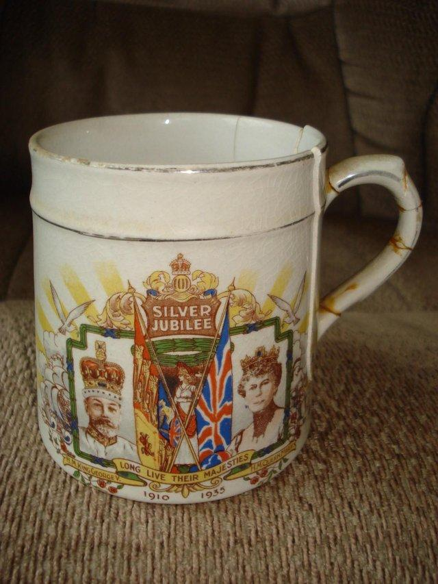 Preview of the first image of ANTIQUE KING GEORGE V QUEEN MARY SILVER JUBILEE 1910-35 MUG.