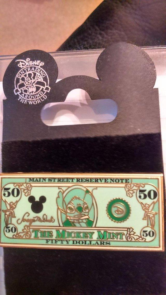Preview of the first image of The Mickey Mint Fifty Dollar Pin Badge.