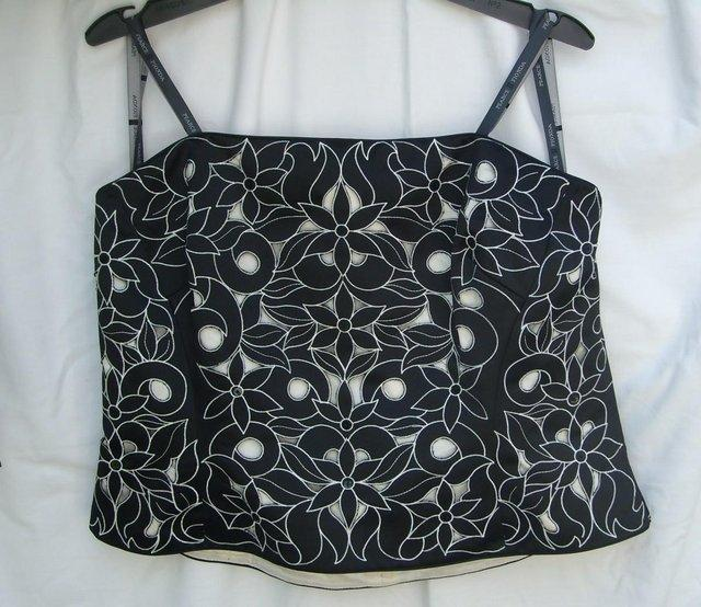 Preview of the first image of PEARCE FIONDA Strapless Black Bustier Top–Size 16.