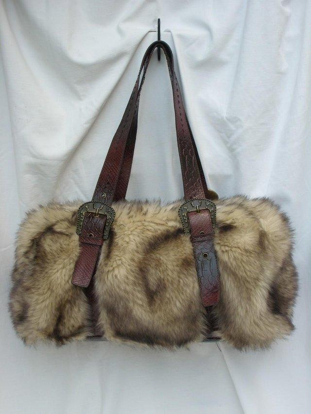 Preview of the first image of DENTS Brown Faux Furry Shoulder Handbag.