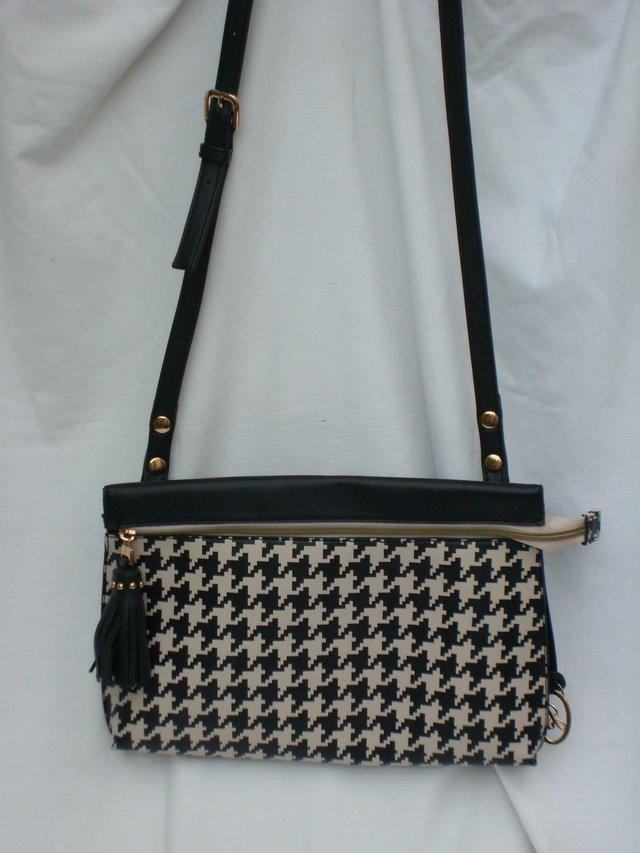 JANE SHILTON cross body bag with tassel detail. Great cross body bag with  black and white dog tooth print on front and plain black back e76a0f13425bd